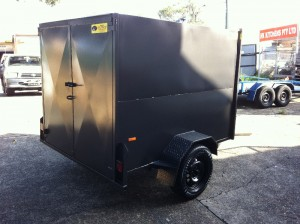 enclosed luggage trailer back side